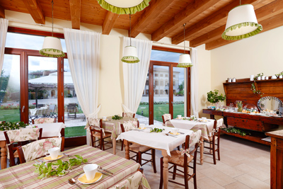 Room where an Italian-style breakfast is served outdoors in summer