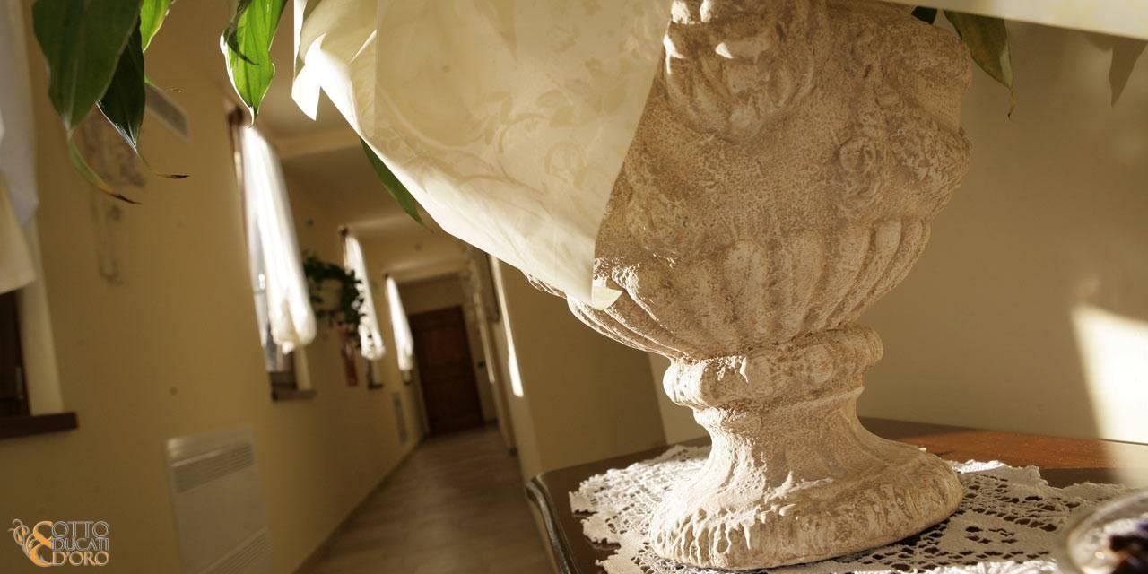 Corridoio con camere al piano terra del Relais Otto Ducati d'Oro