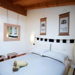 Inaka: camera in stile giapponese con tatami e pavimento in bambù